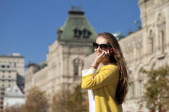 Happy young woman calling by phone Royalty Free Stock Image