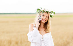 Happy young woman calling on smartphone at country Royalty Free Stock Photos