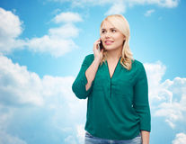 Happy young woman calling on smartphone Royalty Free Stock Image
