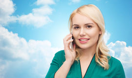 Happy young woman calling on smartphone Stock Photos