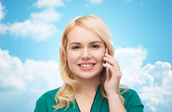 Happy young woman calling on smartphone Stock Photo