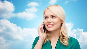 Happy young woman calling on smartphone Royalty Free Stock Photography