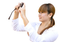 Happy young woman with the camera. Portrait of the happy young woman with the camera Royalty Free Stock Photos