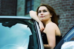 Happy young woman with a car Royalty Free Stock Images