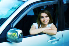 Happy young woman in the car. Stock Images