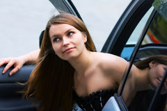 Happy young woman in the car. Stock Photo