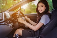 Happy young woman in car royalty free stock image