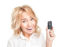Happy young woman with car key on white. Stock Photo