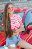 Happy young woman with a car Stock Images