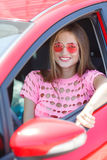 Happy young woman with a car Stock Photos