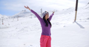 Happy young woman celebrating her winter vacation Royalty Free Stock Image