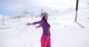 Happy young woman celebrating her winter vacation stock video footage