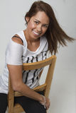 Happy young woman on chair Stock Photography