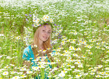 Happy young woman in the chamomile field Royalty Free Stock Photo
