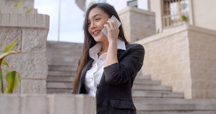 Happy young woman chatting on her mobile Royalty Free Stock Photo