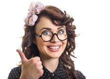 Happy young woman cheering and showing thumbs up Royalty Free Stock Image