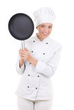 Happy young woman in chef uniform with frying pan isolated on wh Royalty Free Stock Image