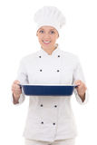 Happy young woman in chef uniform holding ceramic platter isolat Stock Photo