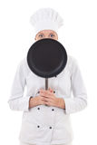 Happy young woman in chef uniform holding frying pan isolated on Royalty Free Stock Photography