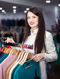 Happy young woman choosing clothes Royalty Free Stock Images