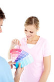 Happy young woman choosing colors for a room Stock Photo