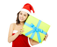 Happy young woman with a christmas gift box Royalty Free Stock Images