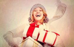 Happy Young Woman with Christmas Gifts Stock Images