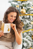Happy young woman with christmas letter near christmas tree Stock Image
