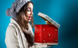 Happy young woman with Christmas present box Stock Photo