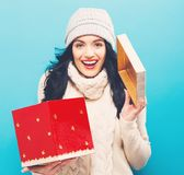 Happy young woman with Christmas present box Royalty Free Stock Images