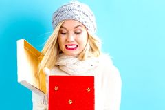 Happy young woman with Christmas present box stock images