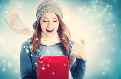 Happy young woman with Christmas present box Royalty Free Stock Photos