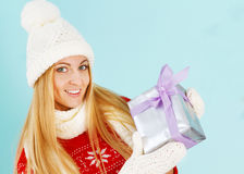 Happy young woman with Christmas present in hands Royalty Free Stock Photography