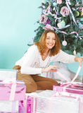 Happy young woman with Christmas present in her hands Royalty Free Stock Photo