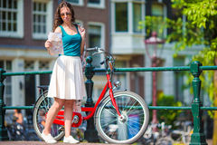 Happy young woman with city map and bikes in Stock Photo