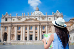 Happy young woman with city map in Vatican city and St. Peter's Basilica church, Rome, Italy. Travel tourist woman with Royalty Free Stock Photography
