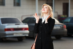 Happy young woman on the city street Royalty Free Stock Photos