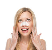 Happy young woman with clear-up strips on nose. Isolated on white royalty free stock photography