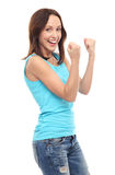Happy young woman clenching fists Stock Images