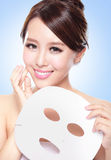 Happy Young woman with cloth facial mask Stock Photo