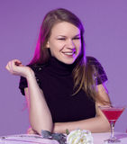 Happy young woman with cocktail Royalty Free Stock Photography