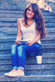 Happy young woman by a coffee cup Royalty Free Stock Photography