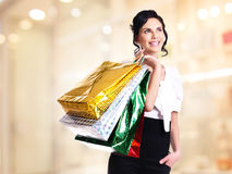 Happy young woman with color bags. Stock Images