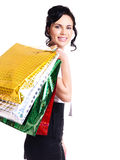 Happy young woman with color bags. Royalty Free Stock Image