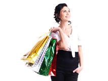 Happy young woman with color bags. Royalty Free Stock Photography