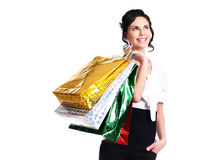 Happy young woman with color bags. Stock Photo