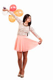 Happy young woman with colorful balloons Stock Photography