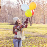 Happy Young Woman With Colorful Balloons Stock Image