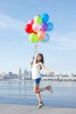 Happy young woman with colorful balloons Stock Images