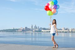Happy young woman with colorful balloons Royalty Free Stock Photography